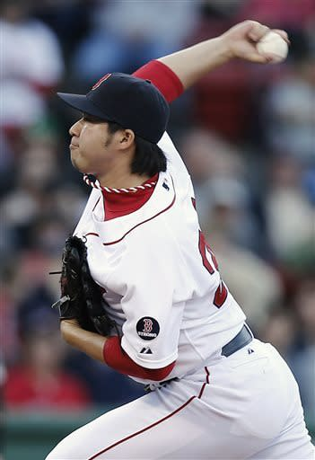 Boston Red Sox relief pitcher Junichi Tazawa, of Japan, delivers against the Oakland Athletics during the sixth inning of a baseball game at Fenway Park in Boston, Wednesday, April 24, 2013. (AP Photo/Winslow Townson)