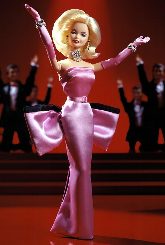 "<div class=""caption-credit""> Photo by: barbiecollector.com</div><b>Barbie as Marilyn in ""Gentlemen Prefer Blondes,"" released in 1997 for $59.97</b> <br> Somehow this bow butt looks more flattering in real life, but Barbie convinces us that ""Diamonds are a Girl's Best Friend."" She's even got her beauty mark."