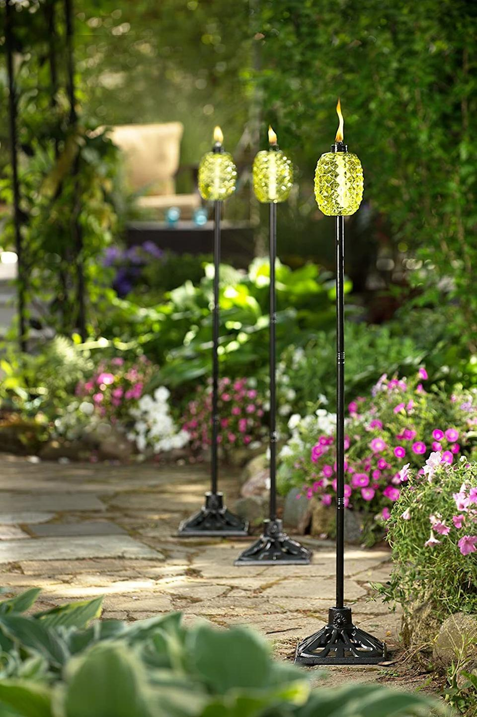 """This torch will add a little SpongeBob flair to yourgarden and provide just the right amount of light for nighttime activities. Plus, you can take off the metal pole part and use it as a table centerpiece!<br /><br /><strong>Promising review:</strong>""""This pineapple torch couldn't be cuter. I bought a few for my home in Florida and the decor is just perfect.<strong>I love how cute they look in my yard even when I am not using them.</strong>The tiki fuel that goes with the torches is also great for keeping bugs away."""" —<a href=""""https://amzn.to/3azIgXn"""" target=""""_blank"""" rel=""""nofollow noopener noreferrer"""" data-skimlinks-tracking=""""5580838"""" data-vars-affiliate=""""Amazon"""" data-vars-href=""""https://www.amazon.com/gp/customer-reviews/R2MQ6PJJCQ1CPX?tag=bfgenevieve-20&ascsubtag=5580838%2C7%2C33%2Cmobile_web%2C0%2C0%2C1159931"""" data-vars-keywords=""""cleaning,fast fashion"""" data-vars-link-id=""""1159931"""" data-vars-price="""""""" data-vars-product-id=""""16176775"""" data-vars-retailers=""""Amazon"""">Amazon Customer</a><br /><br /><strong>Get it from Amazon for<a href=""""https://amzn.to/2Qhfh3R"""" target=""""_blank"""" rel=""""nofollow noopener noreferrer"""" data-skimlinks-tracking=""""5580838"""" data-vars-affiliate=""""Amazon"""" data-vars-asin=""""B078PVLC59"""" data-vars-href=""""https://www.amazon.com/dp/B078PVLC59?tag=bfgenevieve-20&ascsubtag=5580838%2C7%2C33%2Cmobile_web%2C0%2C0%2C1159987"""" data-vars-keywords=""""cleaning,fast fashion"""" data-vars-link-id=""""1159987"""" data-vars-price="""""""" data-vars-product-id=""""16176774"""" data-vars-product-img=""""https://m.media-amazon.com/images/I/41JNwKtplkL.jpg"""" data-vars-product-title=""""TIKI 1117095 Outdoor Torch, 65"""", Green"""" data-vars-retailers=""""Amazon"""">$32.92</a>.</strong>"""
