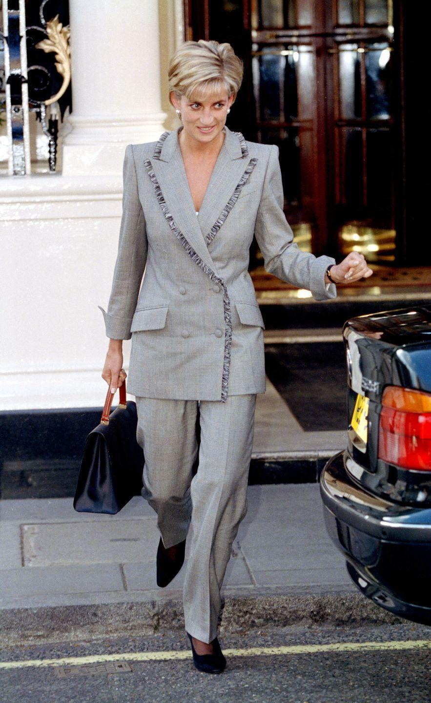 <p>In a gray suit and black velvet shoes at the Connaught Hotel in Mayfair. </p>