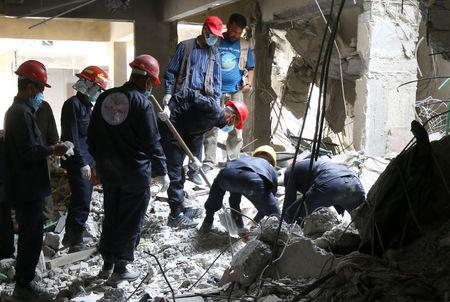 Rescue workers search for bodies still trapped under mounds of debris in Raqqa, Syria April 9, 2018. Picture taken April 9, 2018. REUTERS/Aboud Hamam