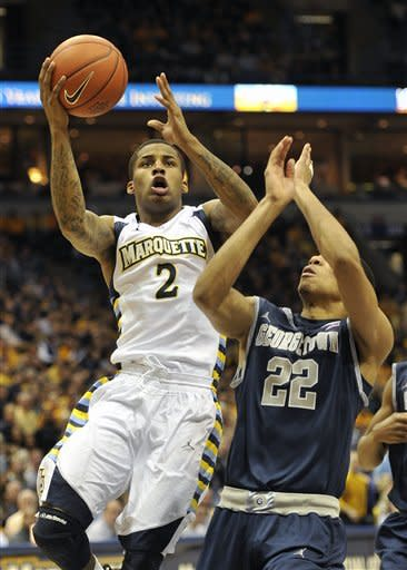 Marquette's Vander Blue (2) drives to the basket against Georgetown's Otto Porter (22) during the first half of an NCAA college basketball game, Saturday, March 3, 2012, in Milwaukee. (AP Photo/Jim Prisching)