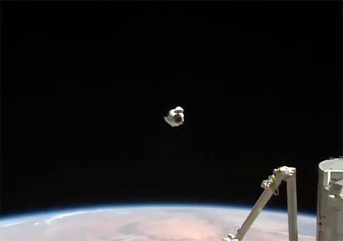 The Crew Dragon, as you can see here, retreated to a point about 180 feet before the station, then climbed to a point just above the space-facing harbor of the Harmony Module and returned for docking.  / Credit: NASA TV