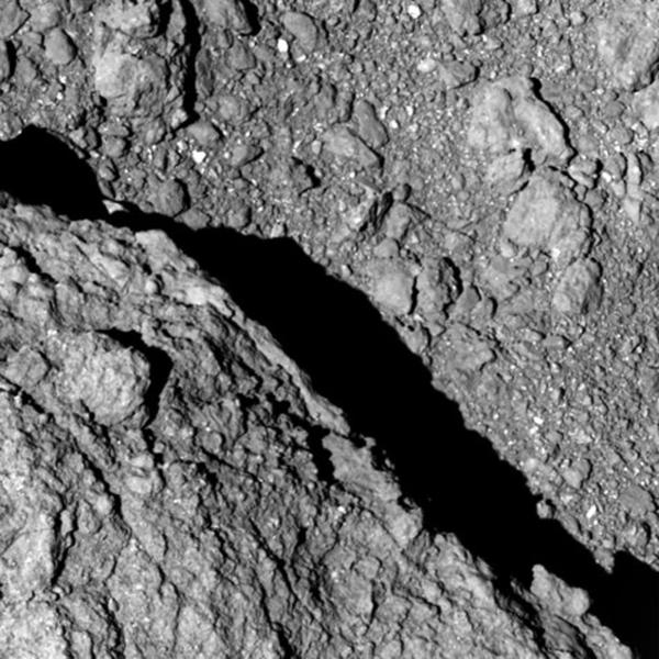 This Sept. 21, 2018 image taken at an altitude of about 64 meter by Hayabusa2 and provided Sept. 27 by the Japan Aerospace Exploration Agency (JAXA) shows the surface of asteroid Ryugu. New photos taken on the surface of an asteroid show that it is (drumroll, please) ... rocky. It may be no surprise, but Japan space agency scientists and engineers are nonetheless thrilled by the images being sent to Earth by two jumping robotic rovers that they dropped onto an asteroid about 280 million kilometers (170 million miles) away. The Japan Aerospace Exploration Agency posted the latest photos on its website late Thursday, Sept. 27. (JAXA, The University of Tokyo and partner institutions via AP)