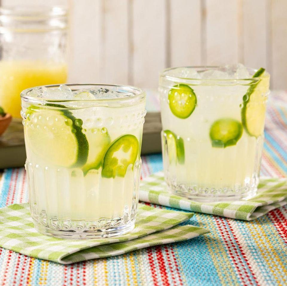 """<p>The only thing that rivals the heat of the sun is this spicy margarita. This recipe infuses the tequila with fresh jalapeño peppers for an extra kick.</p><p><a href=""""https://www.thepioneerwoman.com/food-cooking/recipes/a35824437/spicy-jalapeno-margarita/"""" rel=""""nofollow noopener"""" target=""""_blank"""" data-ylk=""""slk:Get the recipe."""" class=""""link rapid-noclick-resp""""><strong>Get the recipe. </strong></a></p><p><a class=""""link rapid-noclick-resp"""" href=""""https://go.redirectingat.com?id=74968X1596630&url=https%3A%2F%2Fwww.walmart.com%2Fsearch%2F%3Fquery%3Dcocktail%2Bshaker&sref=https%3A%2F%2Fwww.thepioneerwoman.com%2Ffood-cooking%2Fmeals-menus%2Fg36432840%2Ffourth-of-july-drinks%2F"""" rel=""""nofollow noopener"""" target=""""_blank"""" data-ylk=""""slk:SHOP COCKTAIL SHAKERS"""">SHOP COCKTAIL SHAKERS</a></p>"""