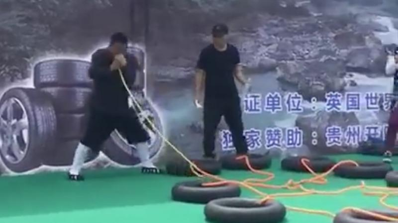Chinese showman sets world record by blowing up 12 tyres through his nostril