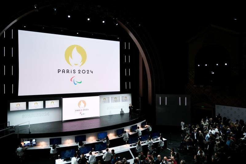 People attend a logo presentation ceremony for Paris 2024 Olympic Games at the Grand Rex cinema in Paris on October 21, 2019. (Photo by STEPHANE DE SAKUTIN / AFP) (Photo by STEPHANE DE SAKUTIN/AFP via Getty Images)