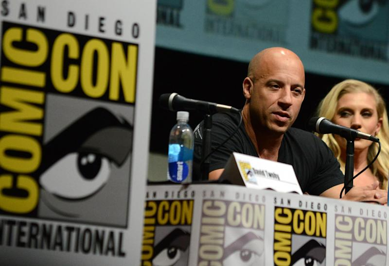 "Vin Diesel, left, and Katee Sackhoff attend ""Riddick"" panel on Day 3 of Comic-Con International on Friday, July 19, 2103, in San Diego. (Photo by Jordan Strauss/Invision/AP)"