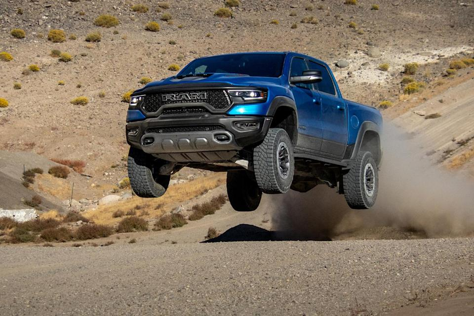 A blue 2021 Ram 1500 TRX pickup gets some airtime