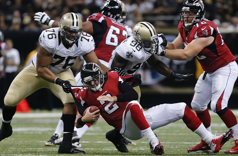 Atlanta Falcons quarterback Matt Ryan (2) is sacked by New Orleans Saints defensive tackle Akiem Hicks (76) as Falcons tackle Sam Baker (72) tries to box out Saints linebacker Parys Haralson (98) in the second half of an NFL football game in New Orleans, Sunday, Sept. 8, 2013. (AP Photo/Bill Haber)