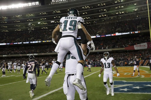 Philadelphia Eagles wide receiver Golden Tate (19) celebrates his touchdown reception with offensive tackle Lane Johnson (65). (AP Photo/Nam Y. Huh)