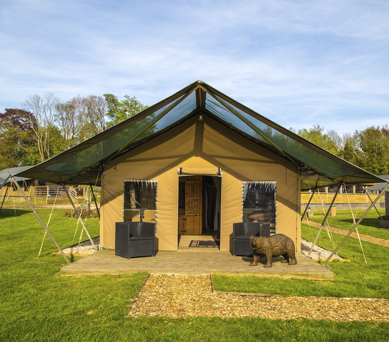 """<p>Bringing slightly more exotic safaris to the Kent countryside, the Aspinall Foundation's Port Lympne estate will transport guests off on the long-haul adventure they've probably spent the last year dreaming of, while remaining grounded on British soil. The resident animals include tigers, lions, giraffes and wolves – but if it's ursine friends you're looking to make, book one of the Bear Lodges, which are located near the bear habitat of the 600-acre reserve. Each lodge sleeps up to eight guests, with proper beds, ensuite bathrooms, tea-making kits and a fridge – but they're also helpfully close to the Clubhouse (and its restaurant and bar). </p><p>Bear Lodge, Port Lympne, Hythe Kent. Visit <a href=""""https://www.aspinallfoundation.org/port-lympne/short-breaks/bear-lodge/?_ga=2.40716832.360278085.1614614940-656808917.1610356358"""" rel=""""nofollow noopener"""" target=""""_blank"""" data-ylk=""""slk:aspinallfoundation.co.uk"""" class=""""link rapid-noclick-resp"""">aspinallfoundation.co.uk</a> for more information.<br></p>"""