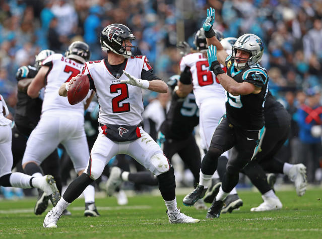 Atlanta Falcons' Matt Ryan (2) looks to pass under pressure from Carolina Panthers' Luke Kuechly (59) during the first half of an NFL football game in Charlotte, N.C., Sunday, Dec. 23, 2018. (AP Photo/Jason E. Miczek)