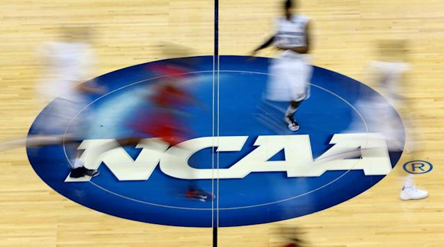 "<p>On Friday, the ongoing college basketball scandal that became public when the FBI released its preliminary findings from a multi-year investigation in September of last year took a major turn. <a href=""http://facebook.com"" rel=""nofollow noopener"" target=""_blank"" data-ylk=""slk:Yahoo! Sports"" class=""link rapid-noclick-resp"">Yahoo! Sports</a> published documents from that FBI probe that detailed the expenditures of disgraced former NBA agent Andy Miller, his former associate Christian Dawkins and the agency he ran, ASM Sports. Dawkins was arrested on three counts of wire fraud and one count of money laundering conspiracy. </p><p>Included in those documents are expense reports and balance sheets that detail what appear to be a number of illegal bribes, benefits and/or payments to some of the biggest programs and most prominent current and former players in the sport. </p><p>Here is a list of each player that has been implicated in this widespread investigation, the details and repercussions of which will certainly become more clear as time goes on. All of this information was made available by Yahoo Sports' release of the documents. Also included are whether the player will continue to play. </p><p>It's important to note that none of these players have yet been punished by the NCAA. </p><p>A list of programs implicated, as well as what action the programs have taken in response, can be found <a href=""https://www.si.com/college-basketball/2017/09/29/what-we-know-about-each-school-fbi-investigation"" rel=""nofollow noopener"" target=""_blank"" data-ylk=""slk:here"" class=""link rapid-noclick-resp"">here</a>. </p><p>This piece will continue to be updated as more information comes in. </p><h3>Miles Bridges, Michigan State</h3><p>According to the documents, Bridges's mother had lunch with Miller and/or his associates at a place called Redwood Lodge, a meal that cost the agency $70.05. It is not clear whether the agency paid for Bridge's mother's meal. Additionally, Miller's agency allegedly gave Bridges' mother a $400 cash advance. </p><p>Michigan State says it has investigated the matter and submitted its findings to the NCAA, and that Bridges has been cleared to play going forward. Bridges is Michigan State's leading scorer at more than 17 points per game and is a candidate for Big Ten Player of the year. </p><h3>Wendell Carter, Duke</h3><p>Carter had lunch and/or met with Dawkins, per the records. Carter's mother also allegedly had lunch with Dawkins when Carter was a junior in high school. The lunch is listed on the expense sheet as costing $106.36, but it is not clear whether Carter's mother paid for her own meal or not. </p><p>Shortly after the publication of the Yahoo! piece, Duke released a statement saying the university reviewed the matter and did not expect Carter's eligibility to be affected. Carter, a freshman, is averaging 14.5 points, 9.5 rebounds, 2.0 assists and a team-high 2.2 blocks for the Blue Devils. </p><h3>Collin Sexton, Alabama</h3><p>Like Bridges and Carter, Sexton's mention in the documents is in connection to a meal his family members allegedly had with Dawkins. As is the case with those two players, it is not clear whether Sexton's family member paid for his/her meal or not. </p><p>Alabama has said that Sexton will continue to play unless anything changes. The freshman is the team's leading scorer at 18.4 points per game. </p><h3>Kevin Knox, Kentucky</h3><p>Knox is another player whose family member(s) allegedly had lunch with Dawkins, and it is also not clear whether they paid for their share of the meal. Kentucky said Knox's elgibility has not been affected by the Yahoo! piece. </p><h3>Chimezie Metu, USC</h3><p>Metu and/or his adviser Johnnie Parker allegedly received $2,000 from the ASM agency. USC said it launched an immediate investigation after the release of the documents and has determined that Metu is eligible to play, but that if more information comes in, the university will act accordingly. </p><p>Metu, a junior, leads the Trojans in scoring (16.0 points per game) and rebounding (7.2). </p><h3>Bennie Boatwright, USC</h3><p>Boatwright and/or his father received $2,000 in a loan or payment, according to the documents. USC has said it will look into Boatwright's eligibility, but he will miss the remainder of the season with a knee injury regardless. </p><h3>Eric Davis, Texas</h3><p>Davis allegedly received a $1,500 loan or payment from the agency. Texas will hold out Davis as it continues to investigate the matter. </p><p>Davis, a junior, is averaging 8.8 points and 2.4 rebounds for the Longhorns. </p><h3>Malik Pope, San Diego State</h3><p>According to the documents, Pope received a payment of $1,400 from ASM Sports. San Diego State announced it will hold Pope out of competition while it looks into the matter. </p><p>The senior is averaging 12.7 points and 7.1 rebounds for the Aztecs. </p><h3>DeAndre Ayton, Arizona</h3><p>Ayton wasn't mentioned in the Yahoo! piece, but he was in an ESPN report that claimed the FBI has conversations in which Arizona coach Sean Miller had multiple conversations with Dawkins regarding a $100,000 payment to secure Ayton's commitment. Ayton will continue to play unless additional information changes the status quo. </p><p>Ayton, a projected top-five pick and a contender for national player of the year, is averaging 19.6 points and 10.9 rebounds. </p><h3>Brian Bowen, Louisville</h3><p>Bowen is referred to as ""Player-10"" in the suit filed against James Gatto, Adidas' former global sports marketing director for basketball. Gatto allegedly funneled $100,000 to Bowen's family—with the knowledge of ""Coach-3,"" believed to be Rick Pitino—to get Bowen to commit to Louisville in May 2017. </p><p>Bowen enrolled at Louisville in August but was suspended when the suit was filed. He has since transferred from Louisville to South Carolina and, barring any punishments from the NCAA, he will be eligible to play for the Gamecocks in January 2019. </p>"