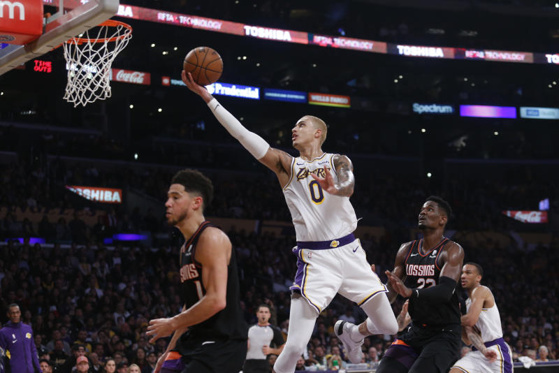 Kyle Kuzma(上籃者)。(AP Photo/Ringo H.W. Chiu)
