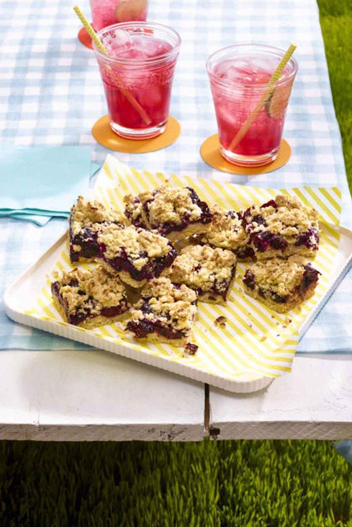 """<p>There's a burst of summer berries in every bite of these bars.</p><p><a href=""""https://www.womansday.com/food-recipes/food-drinks/recipes/a55344/black-and-blue-crumb-bars-recipe/"""" rel=""""nofollow noopener"""" target=""""_blank"""" data-ylk=""""slk:Get the recipe for Crumb Bars."""" class=""""link rapid-noclick-resp""""><u><em>Get the recipe for Crumb Bars.</em></u></a></p>"""