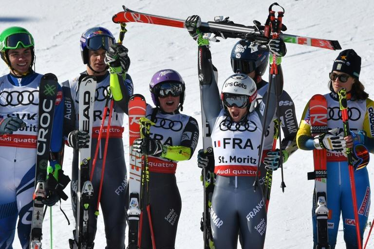 France's skiers celebrate after winning the alpine team event at the World Championships in St Moritz on February 14, 2017