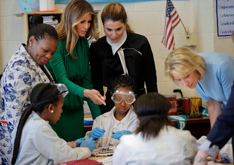 From left, school Principle Dana Bogle, first lady Melania Trump, Queen Rania of Jordan and Education Secretary Betsy DeVos talk with students during a science class at the Excel Academy Public Charter school in Washington, Wednesday, April 5, 2017 - Copyright 2017 The Associated Press. All rights reserved.