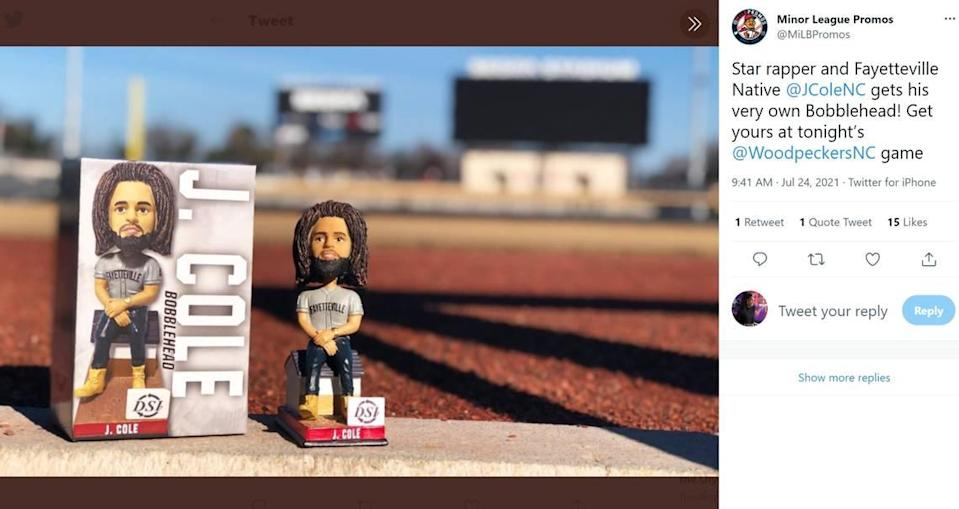 Novelty bobbleheads of rapper J. Cole given to fans at a Fayetteville Woodpeckers game are going for up to $100 online.