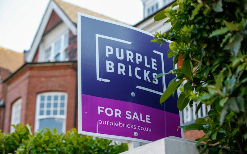 A Purple Bricks for sale sign outside a home - Hollie Adams/Bloomberg