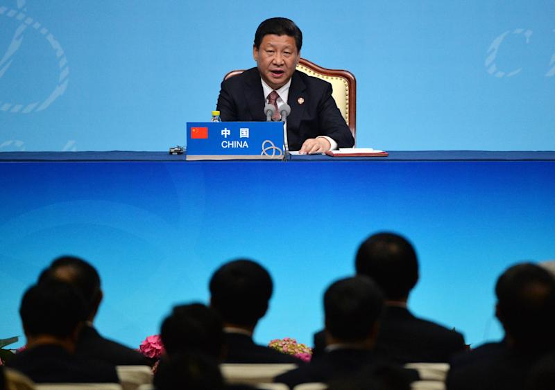 Chinese President Xi Jinping speaks at the closing press conference of the fourth Conference on Interaction and Confidence Building Measures in Asia (CICA) summit at the Expo Center in Shanghai on May 21, 2014 (AFP Photo/Mark Ralston)