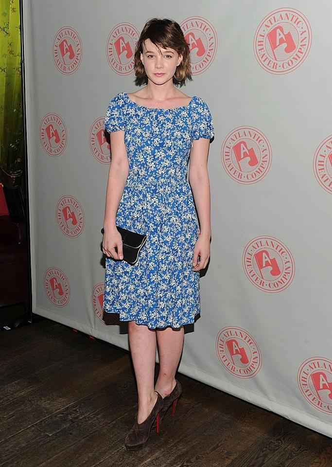 "Oscar nominee Carey Mulligan (""An Education"") rarely smiles on the red carpet, which normally aggravates me. But, this time, I don't blame her. Why? I certainly wouldn't be smiling if I were stuck in a fugly, foral Prada frock and hoof-like Louboutin heels. Jason Kempin/<a href=""http://www.gettyimages.com/"" target=""new"">GettyImages.com</a> - June 6, 2011"