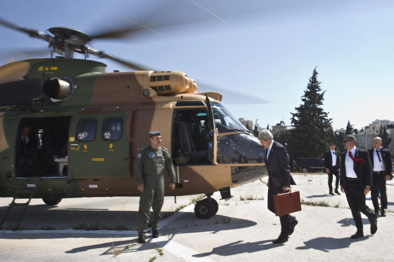 U.S. Secretary of State John Kerry boards a Jordanian helicopter in Jerusalem en route to Amman, Jordan, to meet with Palestinian President Mahmoud Abbas on Saturday, June 29, 2013. On his fifth trip to the Middle East, Kerry met with Abbas for the second time in two days as he continues a rushed round of shuttle diplomacy to restart talks between Israel and the Palestinians. He plans to fly back to Jerusalem later in the day for more talks with Israeli officials. (AP Photo/Jacquelyn Martin, Pool)