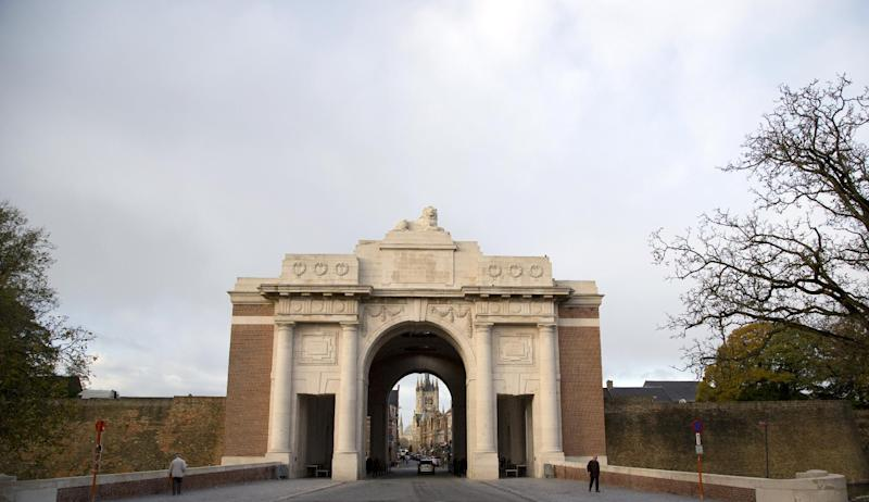 Two people walk near the entrance of the Menin Gate in Ypres, Belgium on Saturday, Nov. 9, 2013. The Menin Gate Memorial bears the names of more than 54,000 British and Commonwealth officers and men who were killed in the Ypres Salient of World War I and whose graves are not known. On Monday, Armistice Day, the Duke of Edinburgh will attend a ceremony and lay a poppy wreath. (AP Photo/Virginia Mayo)