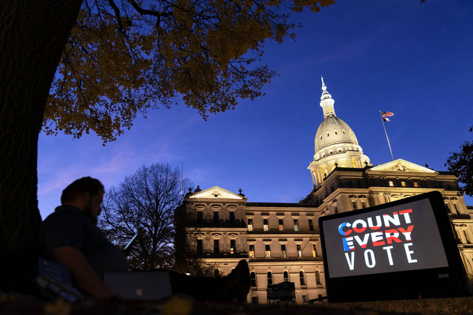 "The phrase ""Count every vote"" is projected on a giant screen in front of the Michigan State Capitol in Lansing on Nov. 6. (David Goldman/AP)"