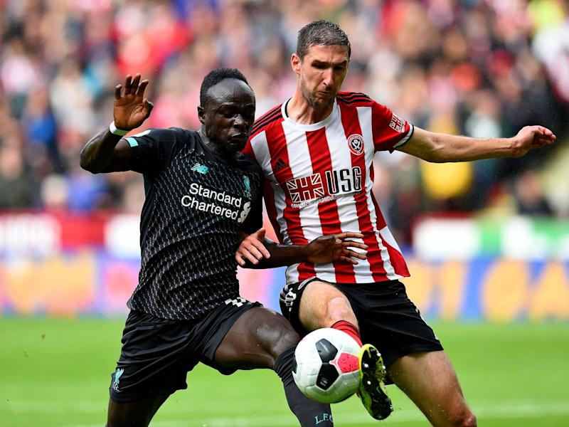 Sadio Mane of Liverpool competing with Jack O'Connell of Sheffield United: Liverpool FC via Getty Images