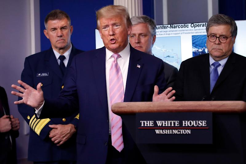 President Donald Trump speaks about the coronavirus on April 1, 2020, as (left to right) Adm. Karl Leo Schultz, commandant of the Coast Guard, national security adviser Robert O'Brien and Attorney General William Barr listen closely. (Photo: Alex Brandon/ASSOCIATED PRESS)