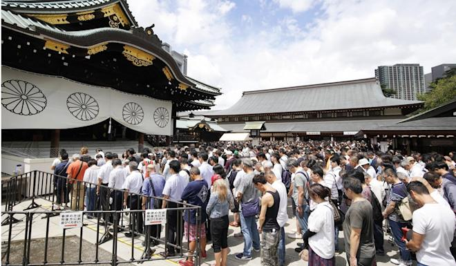Visitors offer a moment of silence at the Yasukuni Shrine in August. Photo: AP