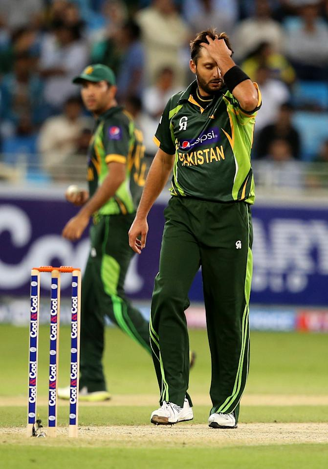 DUBAI, UNITED ARAB EMIRATES - DECEMBER 11:  Shahid Afridi reacts during the first Twenty20 International match between Pakistan and Sri Lanka at Dubai Sports City Cricket Stadium on December 11, 2013 in Dubai, United Arab Emirates.  (Photo by Francois Nel/Getty Images)