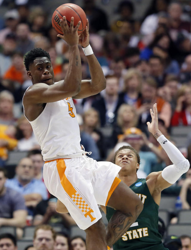Tennessee forward Admiral Schofield (5) looks to make a pass as Wright State forward Everett Winchester (2) defends in the second half of a first-round game of the NCAA college basketball tournament in Dallas, Thursday, March 15, 2018. (AP Photo/Tony Gutierrez)