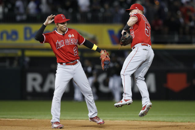 Los Angeles Angels' Andrelton Simmons, left, and Kole Calhoun celebrate their team's win against the Chicago White Sox in a baseball game Saturday, Sept. 7, 2019, in Chicago. (AP Photo/Jim Young)