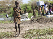 In this Wednesday Dec. 16 2020 photo, a young girl stands near the river in Lekuangole, South Suday, South Sudan is one of four countries with areas that could slip into famine, the United Nations has warned, along with Yemen, Burkina Faso and northeastern Nigeria. (AP Photo/Sam Mednick)