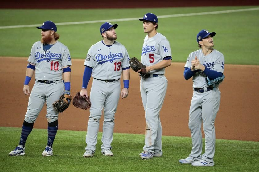 Arlington, Texas, Sunday, October 25, 2020 Dodgers infielders meet near the mound during a pitching change in game five of the World Series at Globe Life Field. Left to right are Justin Turner, Max Muncy, Corey Seager and Kike Martinez. (Robert Gauthier/ Los Angeles Times)