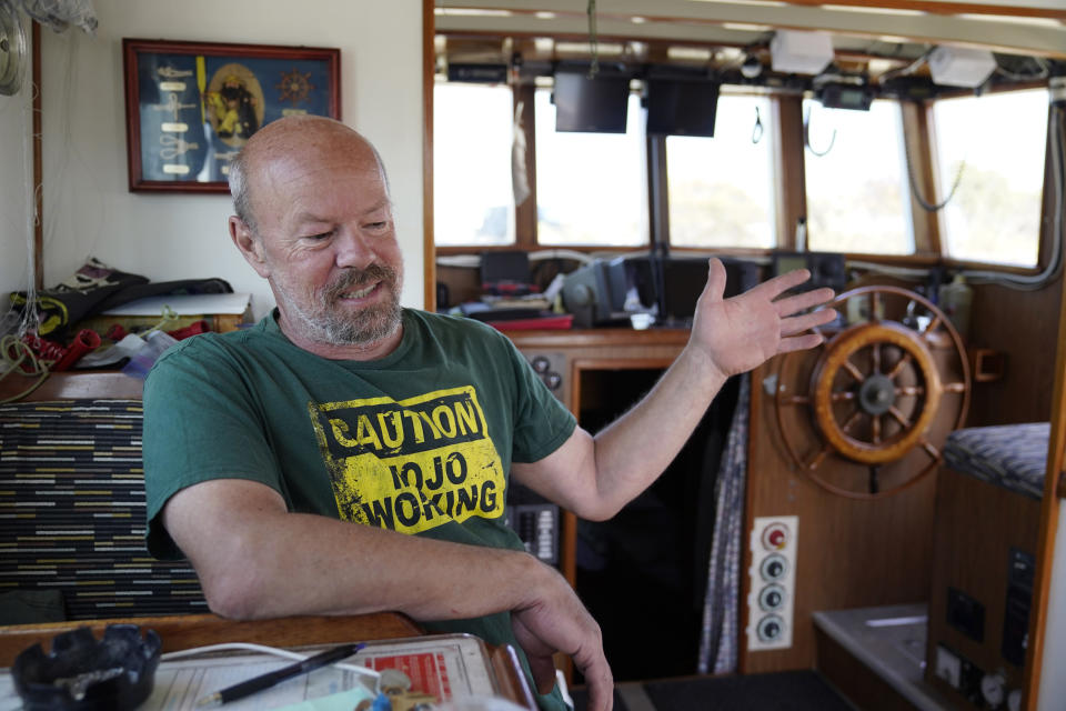 Fisherman Mike Hudson sits in the cabinet of his boat and talks about his most recent small catch of salmon at the Berkeley, Calif., Marina on Thursday, July 22, 2021. Baby salmon are dying by the thousands in one river and an entire run of endangered salmon could be wiped out in another. The plummeting catch has led to skyrocketing retail prices for salmon, hurting customers who say they can no longer afford the $35 per pound of fish, said Hudson, who has spent the last 25 years catching and selling salmon at farmers' markets in Berkeley. (AP Photo/Eric Risberg)