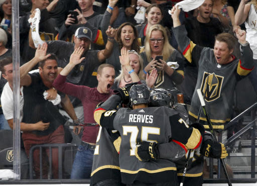 FILE - In this Friday, May 18, 2018, file photo, Vegas Golden Knights left wing Tomas Nosek, left, celebrates with teammates after scoring against the Winnipeg Jets during the second period of Game 4 of the NHL hockey Western Conference finals in Las Vegas. The love affair between a city and its new team wasn't totally unexpected. Las Vegas was, after all, a town starved for major league sports. (AP Photo/John Locher, File)