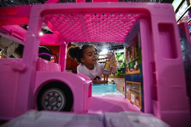 Layla, four, plays with a Barbie 3-in-1 Dream camper during the Hamleys Christmas toy showcase at Hamleys, Regent Street, London