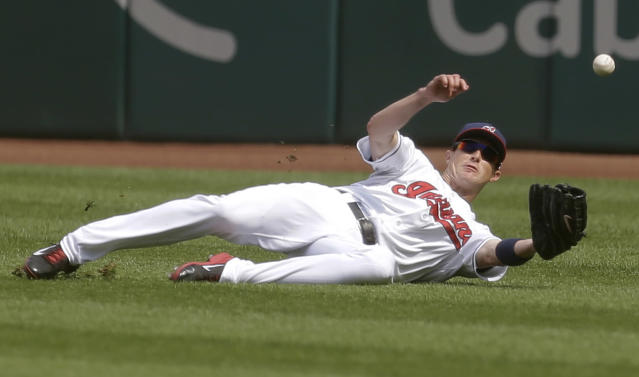 Cleveland Indians' Drew Stubbs dives for a triple hit by Kansas City Royals' Emilio Bonifacio in the first inning of a baseball game, Wednesday, Sept. 11, 2013, in Cleveland. (AP Photo/Tony Dejak)