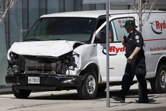 <p>Police inspect a van suspected of being involved in a collision injuring at least eight people at Yonge St. and Finch Ave. on April 23, 2018 in Toronto, Canada. A suspect is in custody after a white van collided with multiple pedestrians. (Photo: Cole Burston/Getty Images) </p>