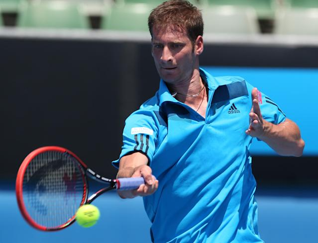 Florian Mayer of Germany makes a forehand return to Jerzy Janowicz of Poland during their third round match at the Australian Open tennis championship in Melbourne, Australia, Friday, Jan. 17, 2014. (AP Photo/Shuji Kajiyama)