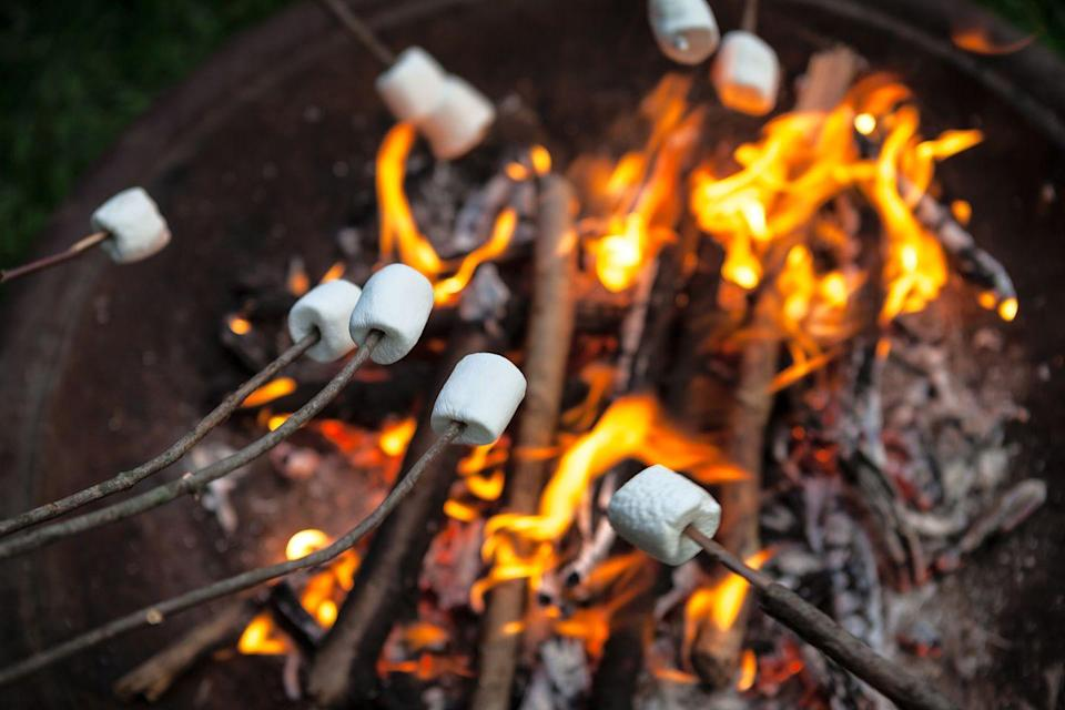 """<p>Head for the backyard fire pit armed with all kinds of fixings you can use to enhance your ingenious <a href=""""https://www.countryliving.com/food-drinks/g2006/smores-dessert-recipes/"""" rel=""""nofollow noopener"""" target=""""_blank"""" data-ylk=""""slk:s'mores recipes"""" class=""""link rapid-noclick-resp"""">s'mores recipes</a>. Sit around the fire and enjoy the chocolatey goo! <br></p><p><strong>RELATED: 53 Easy Camping Recipes for Your Next Trip to the Great Outdoors</strong></p><p><a class=""""link rapid-noclick-resp"""" href=""""https://www.amazon.com/Mainstay-Features-Durable-High-Temperature-Heat-Resistant/dp/B0769WC688/ref=sr_1_4?dchild=1&keywords=fire+pit&qid=1621522057&s=home-garden&sr=1-4&tag=syn-yahoo-20&ascsubtag=%5Bartid%7C10050.g.4463%5Bsrc%7Cyahoo-us"""" rel=""""nofollow noopener"""" target=""""_blank"""" data-ylk=""""slk:SHOP FIRE PITS"""">SHOP FIRE PITS</a> </p>"""