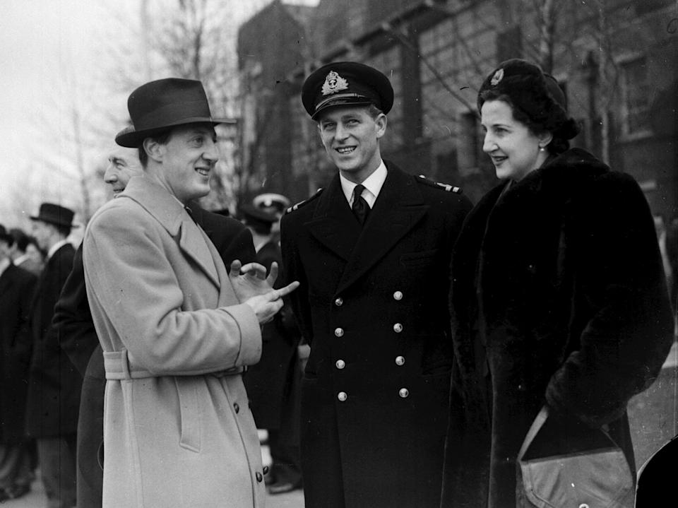 <p>The Prince shared a laugh with his friends, Lord and Lady Brabourne in March 1947. Photo: Getty Images.</p>
