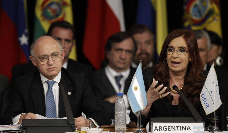 Argentina's President Cristina Fernandez, right, speaks as her Foreign Minister Hector Timerman looks on during a Mercosur summit in Mendoza, Argentina, Friday, June 29, 2012. Fernandez announced that the Mercosur trade bloc will not slap economic sanctions on Paraguay after the removal of its president because they felt it would hurt the Paraguayan people. Mercosur leaders criticized the impeachment and barred President Fernando Lugo's replacement, former Vice President Federico Franco, from attending the summit. (AP Photo/Natacha Pisarenko)