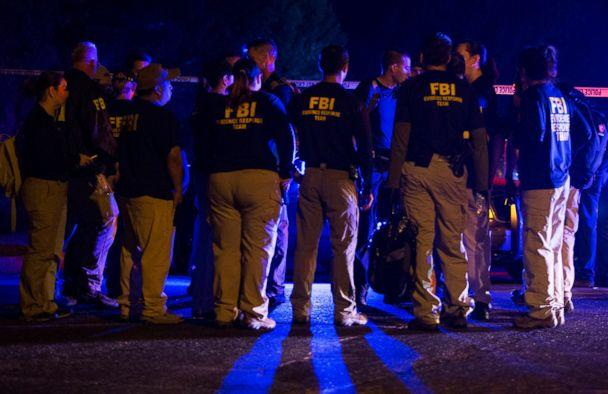 Officials from the FBI gather at the site of explosion in Austin, Texas, on Sunday, March 18