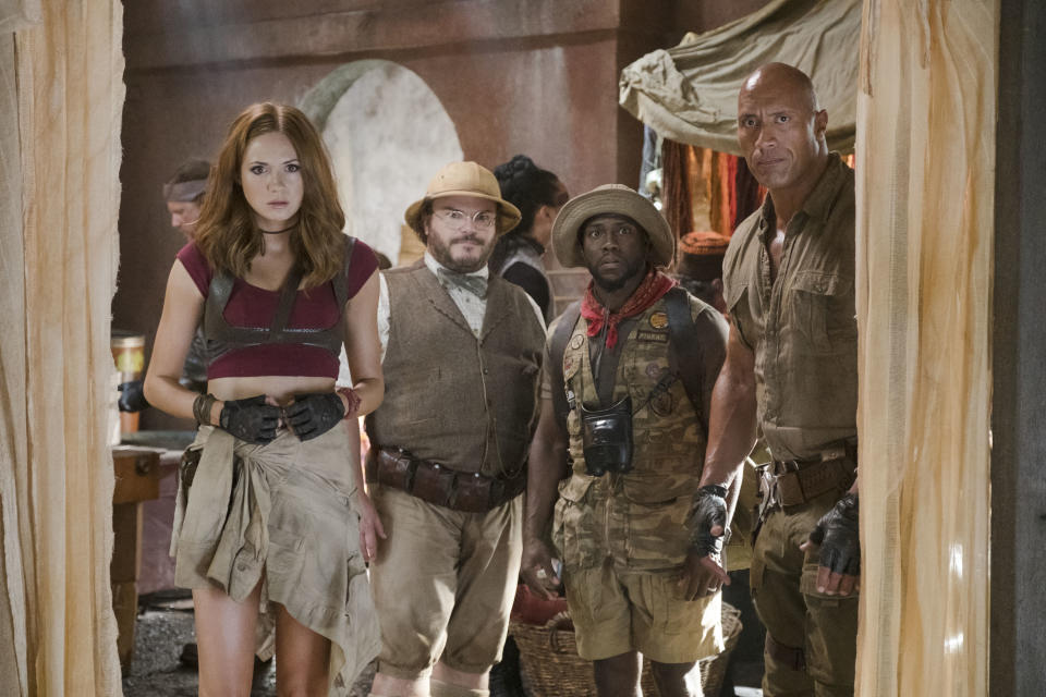"""This image released by Sony Pictures shows Karen Gillan, from left, Jack Black, Kevin Hart and Dwayne Johnson in """"Jumanji: Welcome to the Jungle."""" (Frank Masi/Sony Pictures via AP)"""
