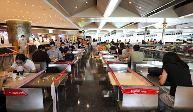Tables are taped off as part of social-distancing rules at a food court at Festival Walk in Kowloon Tong. Photo: May Tse