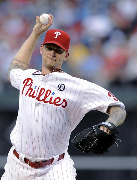 Philadelphia Phillies starting pitcher A.J. Burnett throws a pitch in the first inning of an interleague baseball game against the Seattle Mariners on Tuesday, Aug. 19, 2014, in Philadelphia. (AP Photo/Michael Perez)